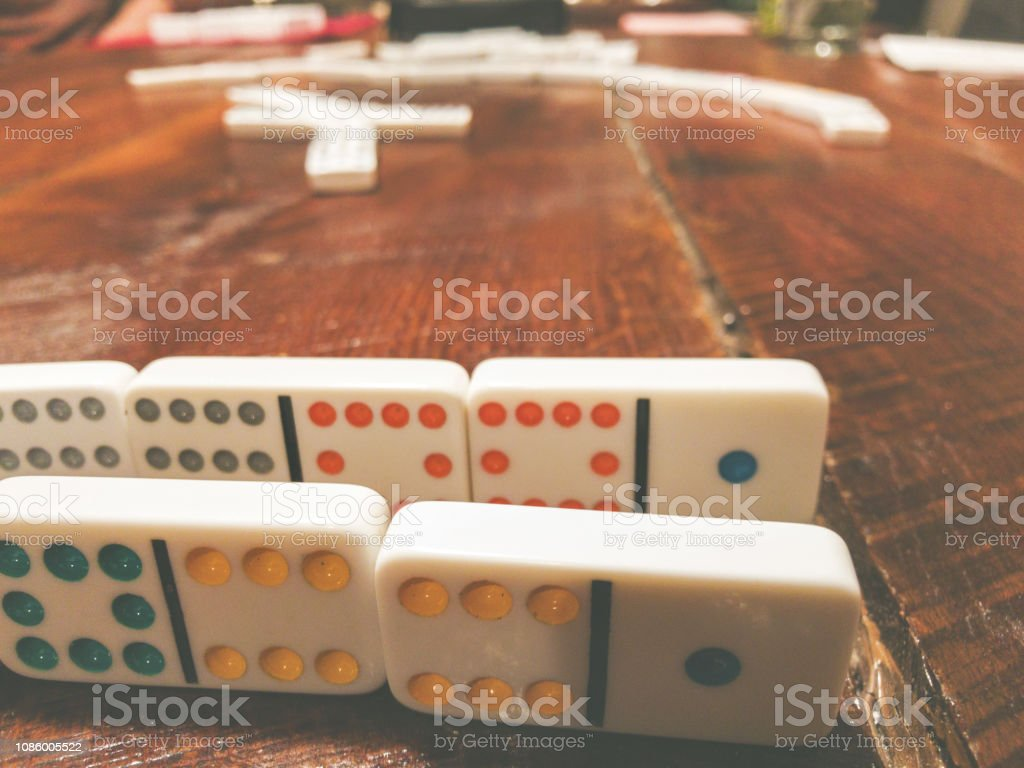 Holidays Dominoes Table Group Game Mexican Train stock photo