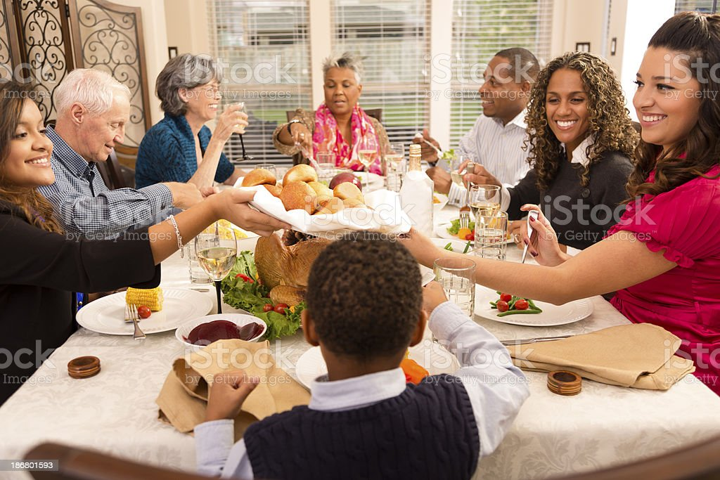 Holidays: Family and friends gather for dinner at grandma's house. stock photo