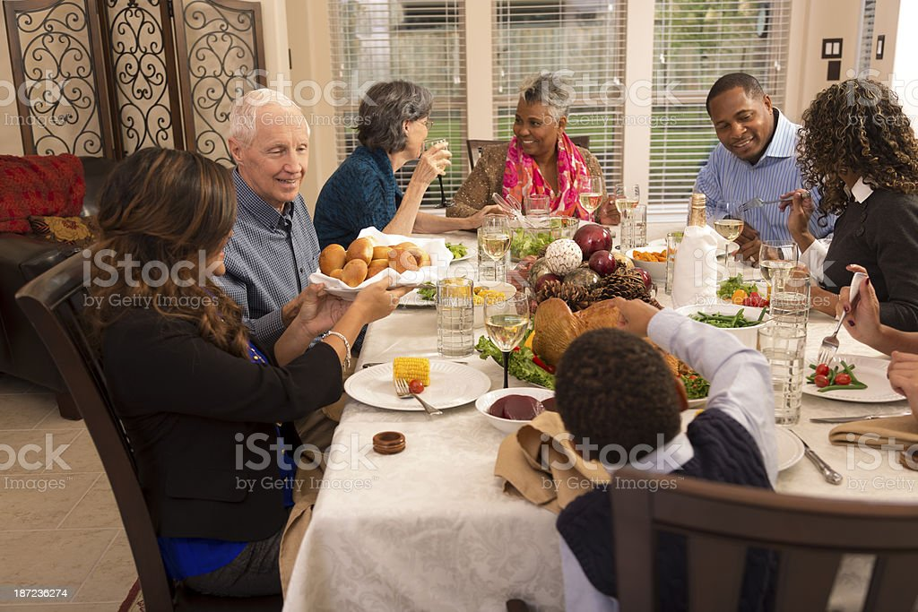Holidays: Family and friends gather for dinner at grandma's house. royalty-free stock photo