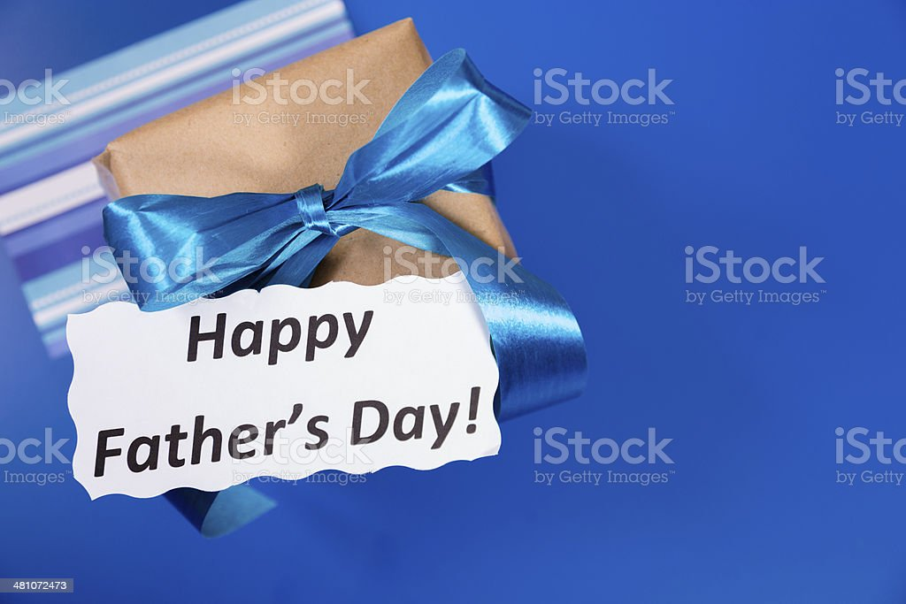 Holidays:  Father's Day gift for dad on blue background. royalty-free stock photo