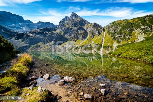 1130859000 istock photo Holidays in Poland - Black Gasienicowy Pond and Koscielec summit in the Tatra Mountains 1211182918