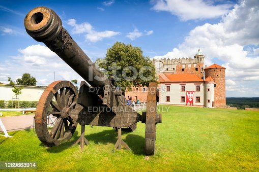 Golub-Dobrzyń, Poland - August 24,2020:Huge medieval cannon on the field in front of Teutonic Castle in Golub-Dobrzyń, Poland