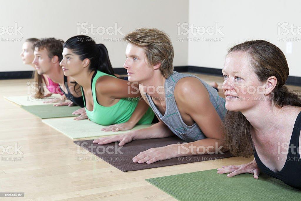 Holistic health: yoga class royalty-free stock photo