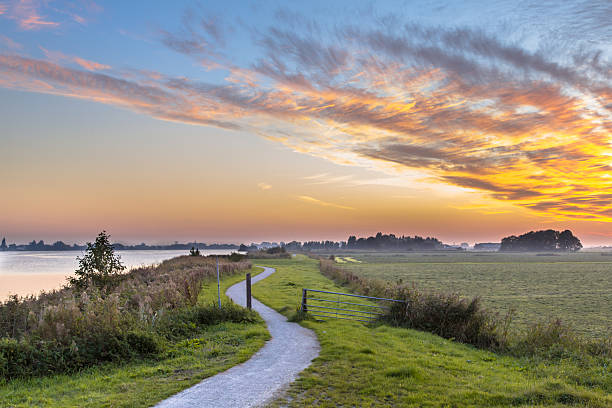 Holland landscape with winding cycling track stock photo