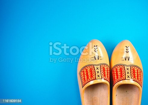istock Holland, Netherlands, Amsterdam, Volendam, Marken, clogs at blue background with copy space for your own text 1161609154