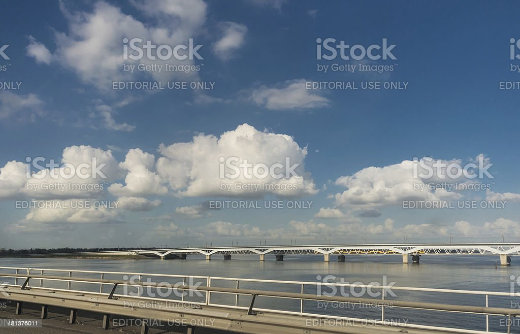 Hollands diep railwaybridge with Train heading south royalty-free stock photo
