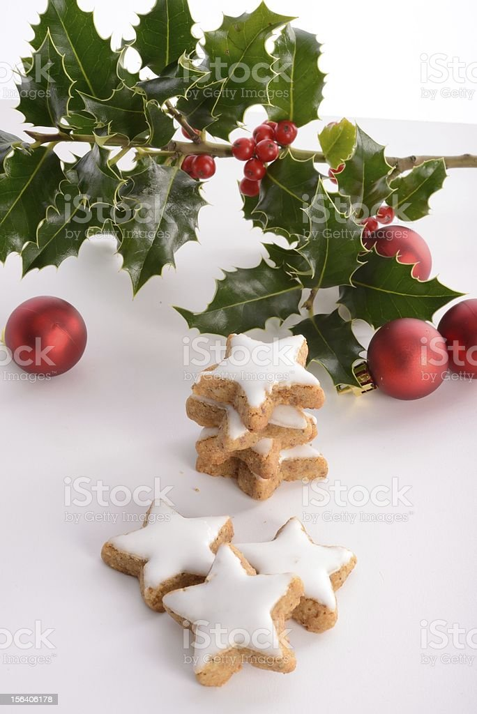 Hollies and gingerbreads royalty-free stock photo