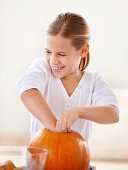 Hollowing out a pumpkin for holloween