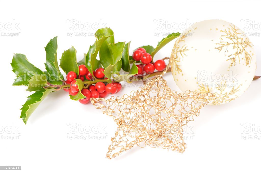 Holly branch and Christmas tree ornaments stock photo