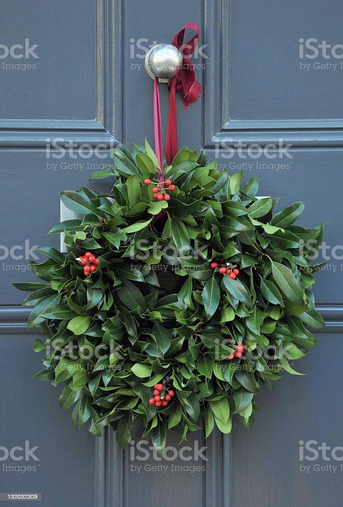 Holly wreath stock photo