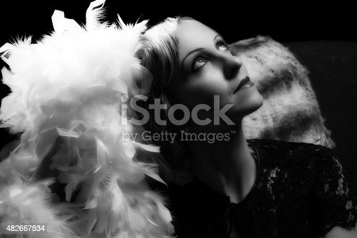 Vintage lady posing with authentic hollywood lighting