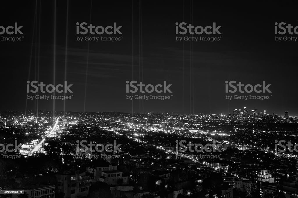 Hollywood and Downtown Los Angeles at night with spot lights stock photo