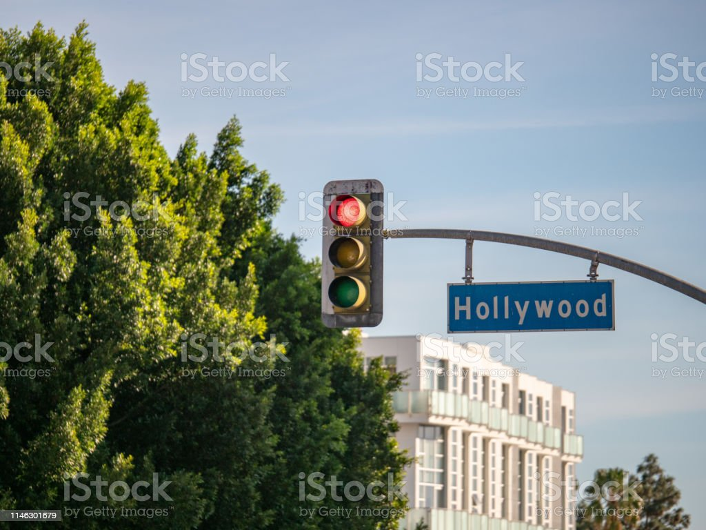 Hollywood Blvd street sign on traffic light at intersection in Los...