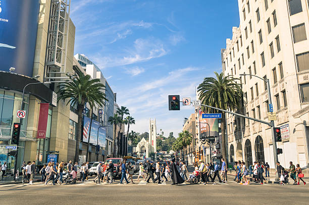 Hollywood Boulevard and Walk of Fame in Los Angeles Los Angeles, United States - March 21, 2015: crowded street with multiracial people walking on Hollywood Boulevard the world famous Walk of Fame created in 1958 as a tribute to artists working in the movie industry. sunset boulevard los angeles stock pictures, royalty-free photos & images