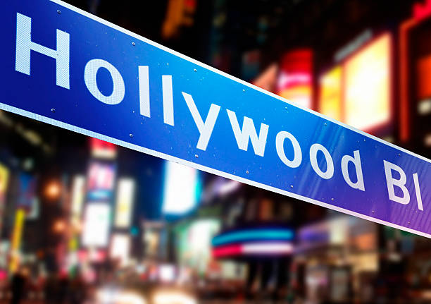 Hollywood Boulevard Hollywood Boulevard signpost by night. See other photos & videos from USA:  hollywood boulevard stock pictures, royalty-free photos & images