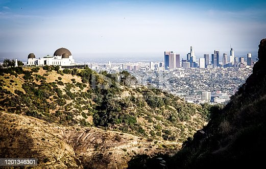 Panoramic view of Downtown Los Angeles and Griffith Observatory from the Hollywood Hills.