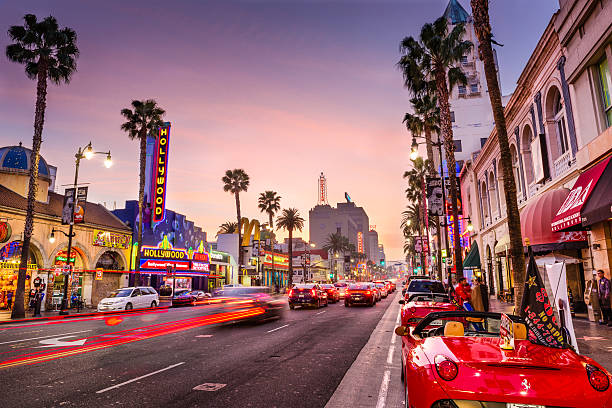 Hollywood, Los Angeles Los Angeles, USA - March 1, 2016: Traffic and pedestrians on Hollywood Boulevard at dusk. The theater district serves as a famous tourist attraction. hollywood boulevard stock pictures, royalty-free photos & images