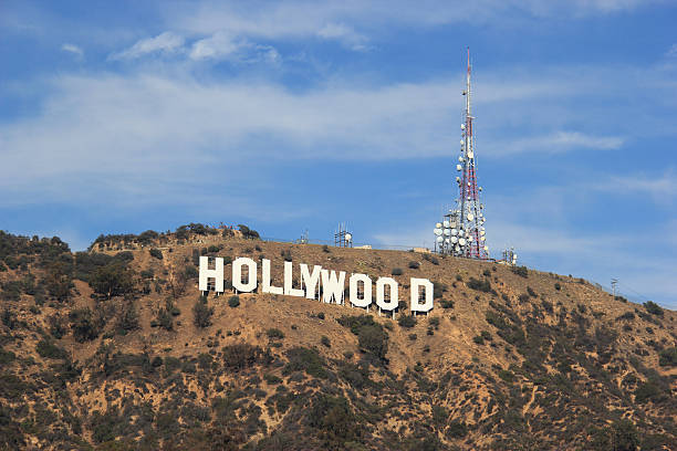 Hollywood Sign Los Angeles, California, USA - November 10, 2014: The Hollywood Sign is a landmark and American cultural icon located on Mount Lee in the Hollywood Hills area of the Santa Monica Mountains in Los Angeles, California. brand name stock pictures, royalty-free photos & images