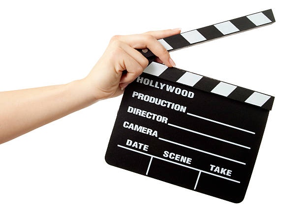 Hollywood Slate board in woman hand isolated stock photo