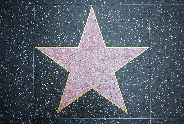 Hollywood Star Los Angeles, USA - June 24, 2011: A blank star on the Hollywood Walk of Fame. Located on Hollywood Boulevard and is one of 2000 celebrity stars made from marble and brass. walk of fame stock pictures, royalty-free photos & images