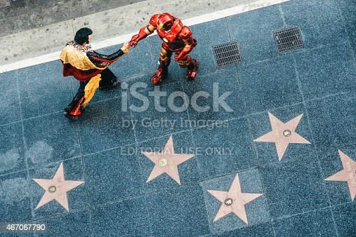 Los Angeles, United States - March 9, 2015: Elvis Presley and Ironman impersonators greeting each other in Hollywood Walk of Fame.
