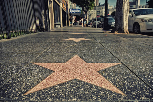 Hollywood Walk of Fame. Los Angeles, CA, USA - February 02, 2018:  Walk of Fame at sunset on Hollywood Boulevard. In 1958, the Hollywood Walk of Fame was created as a tribute to artists working in the entertainment industry. walk of fame stock pictures, royalty-free photos & images