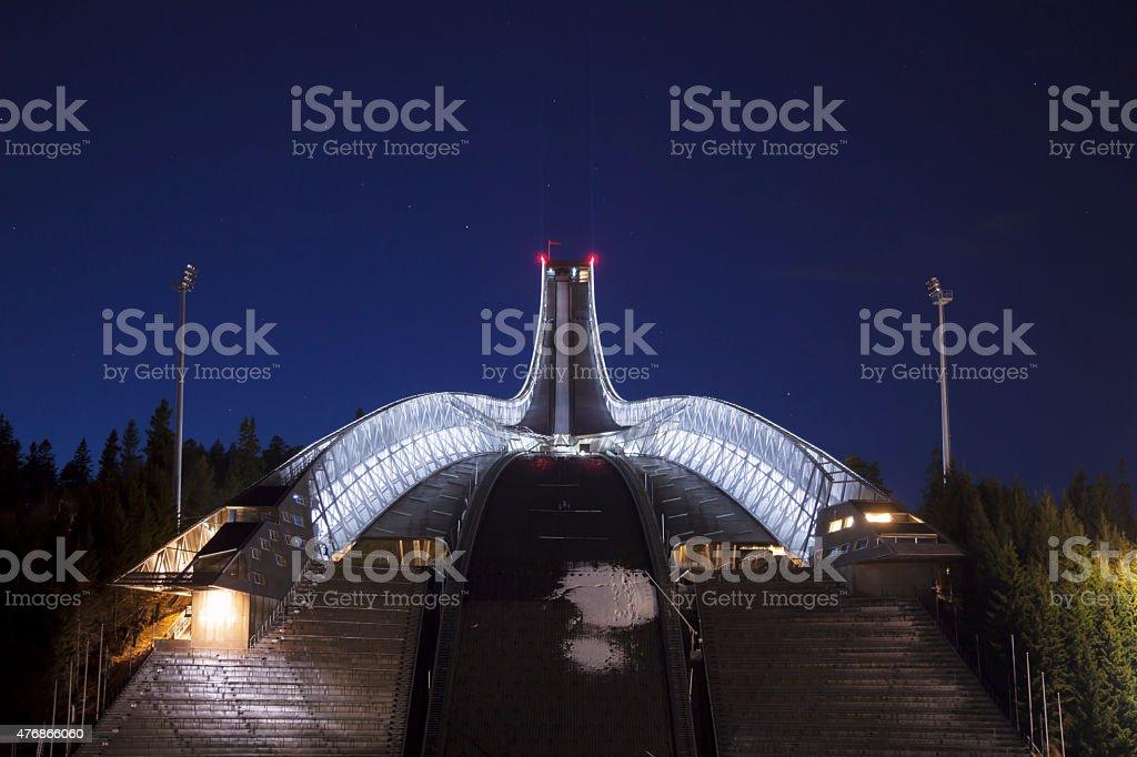 Holmenkollen Ski Arena illuminated at night. stock photo
