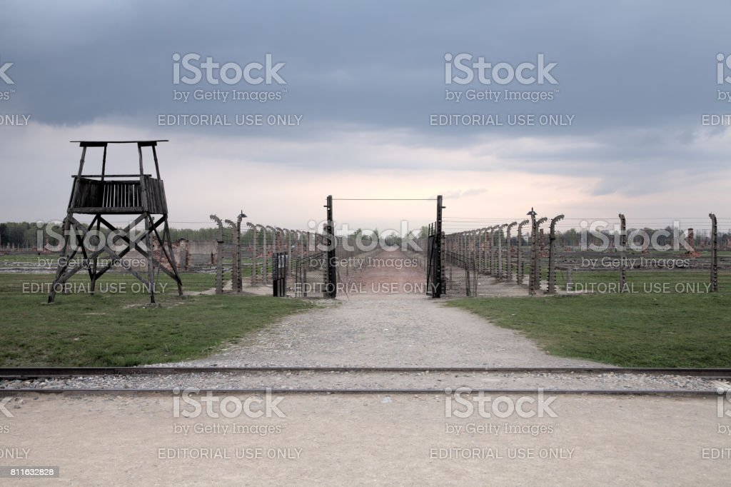 Holocaust Memorial Museum.  Barbed wire and fance inside a concentration camp. Inside entrance and Shed guard. – zdjęcie