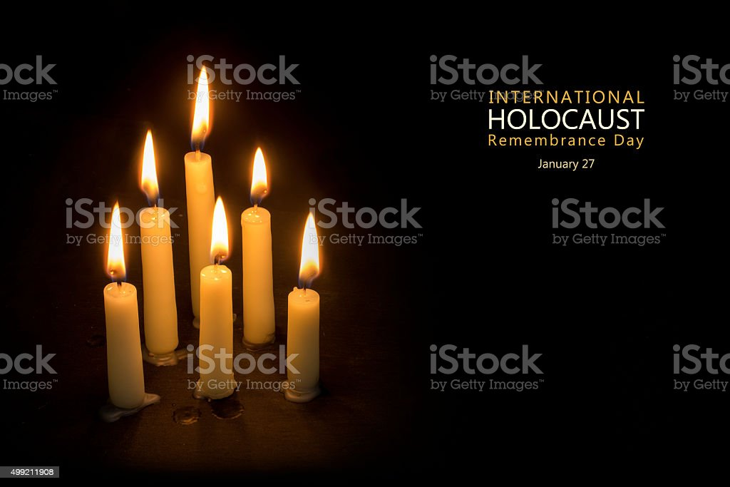 Holocaust Remembrance Day, January 27, candles against black stock photo