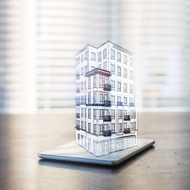 Hologram of a building over a tablet computer stock photo
