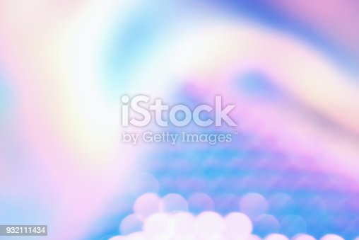 istock Holographic color foil with shiny reflections and bokeh light effect 932111434