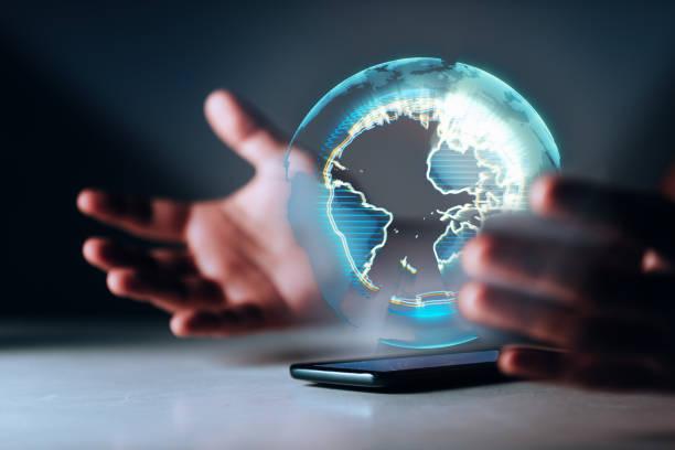 holographic earth on smartphone - hologram imagens e fotografias de stock