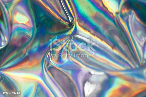 Holographic iridescent abstract blurred surface. Holographic gradient background.