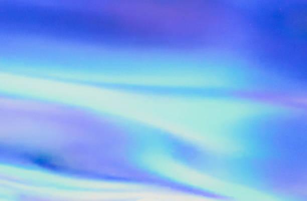 傷や凹凸を持つ青ピンク緑色のホログラフィックの本物の質感 - ホログラム ストックフォトと画像