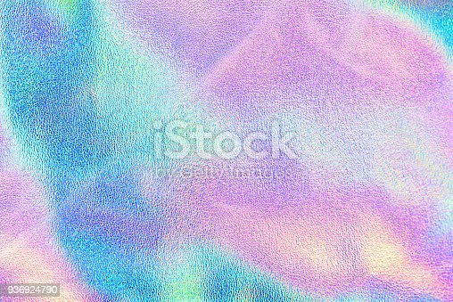 istock Holographic real texture in blue pink green colors with scratches and irregularities 936924790