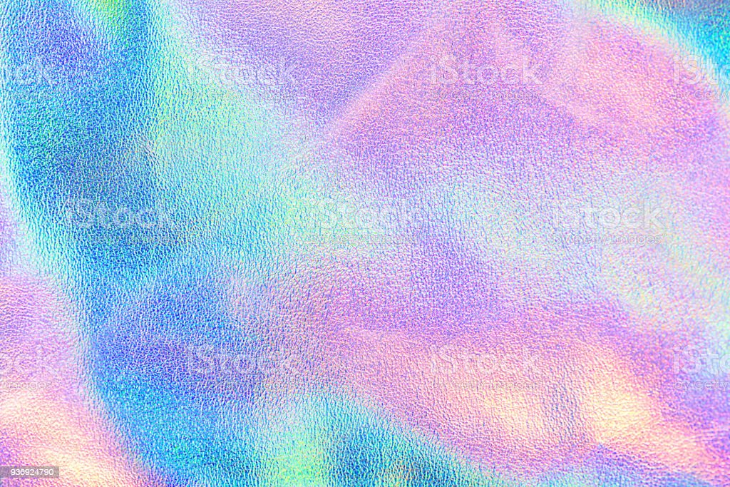 Holographic real texture in blue pink green colors with scratches and irregularities stock photo