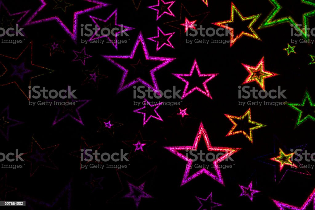 Holographic Stars on Black Background stock photo