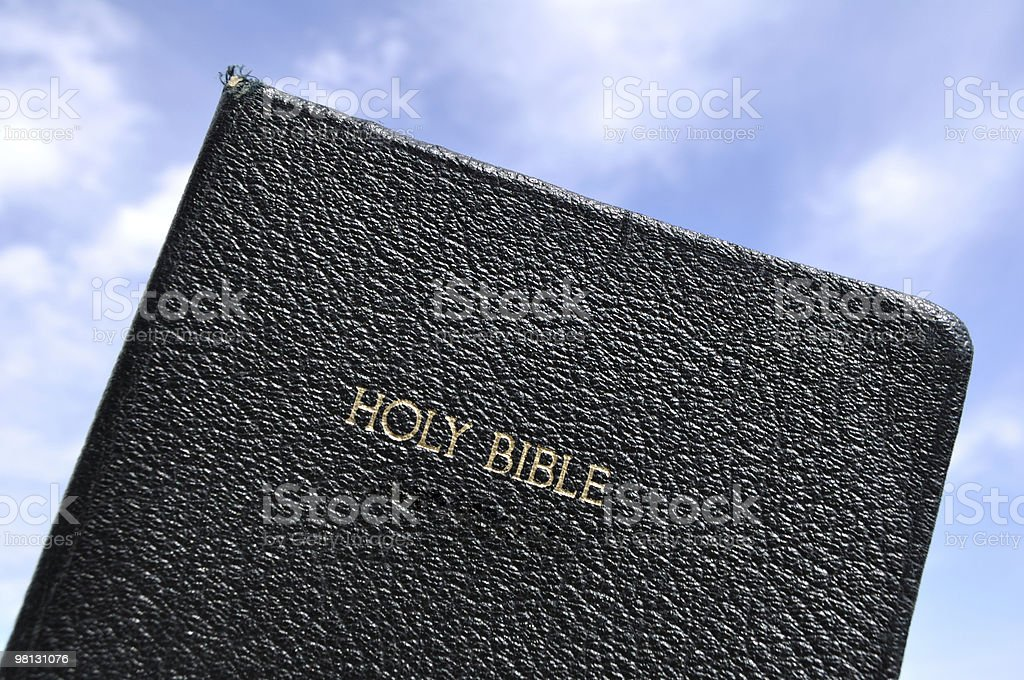 Holy Bible Against a Blue Sky royalty-free stock photo