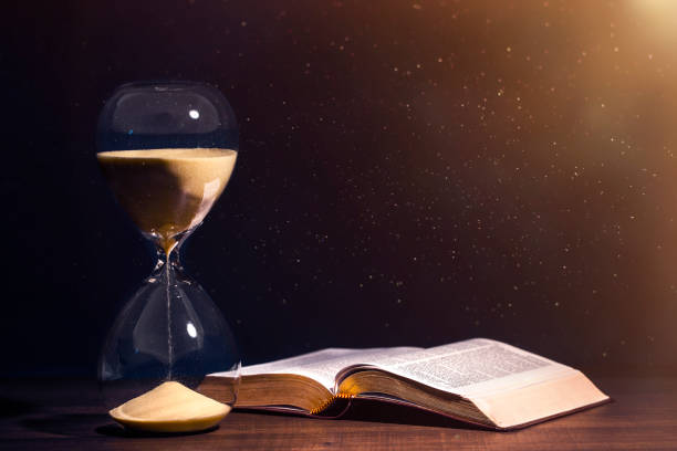 Holy Bible and Countdown Hourglass stock photo