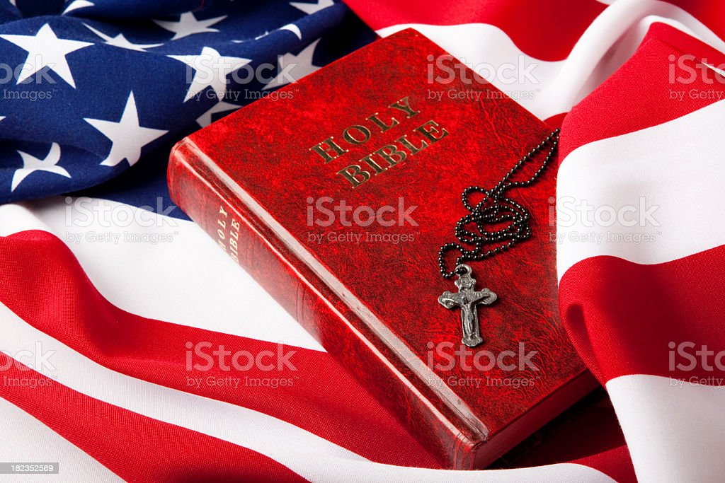 Holy Bible And Cross On American Flag stock photo