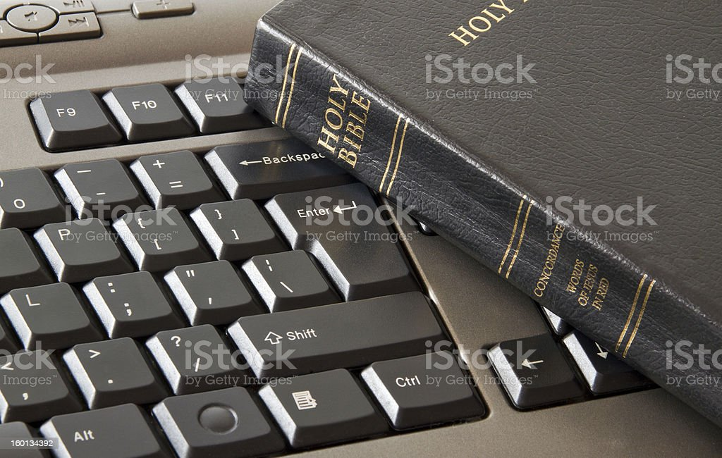 Holy Bible and keyboard royalty-free stock photo