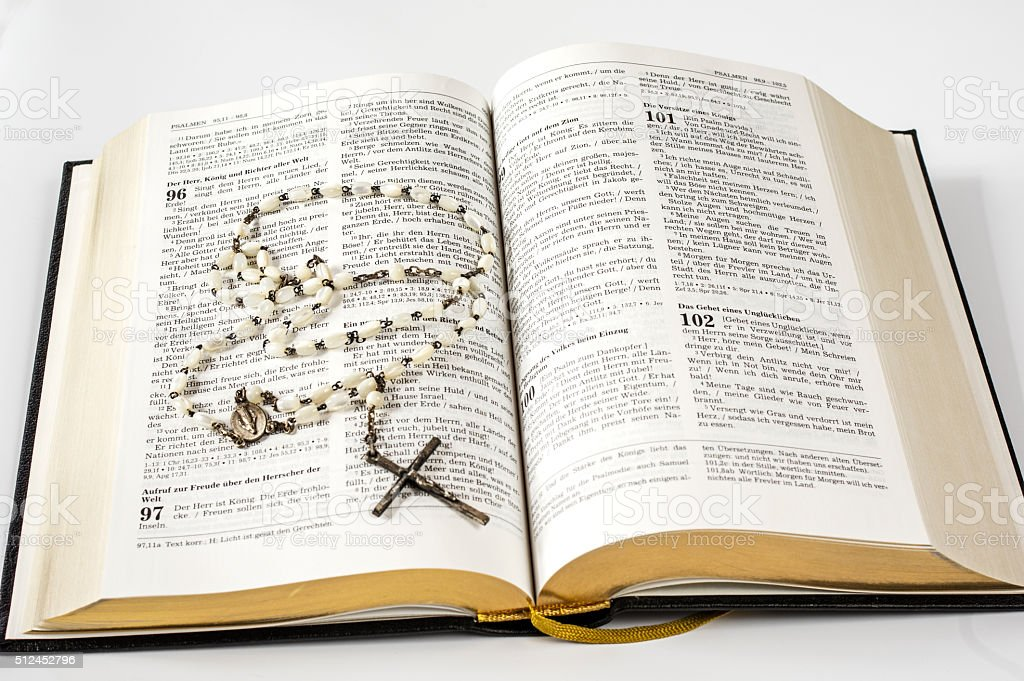 Holy bible and rosary beads stock photo