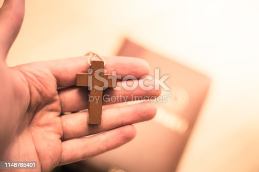 istock Holy bible and rosary: Christian bible and rosary on a wooden desk 1148765401