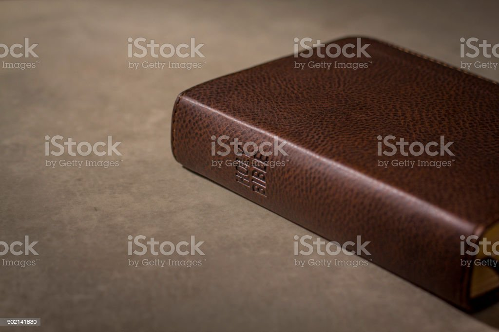 Holy Bible laying down closed stock photo