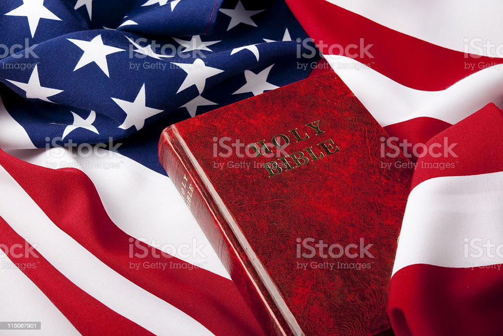 Holy Bible On American Flag For religion And Politics Concept stock photo