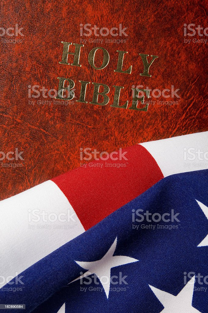 Holy Bible on American Flag stock photo