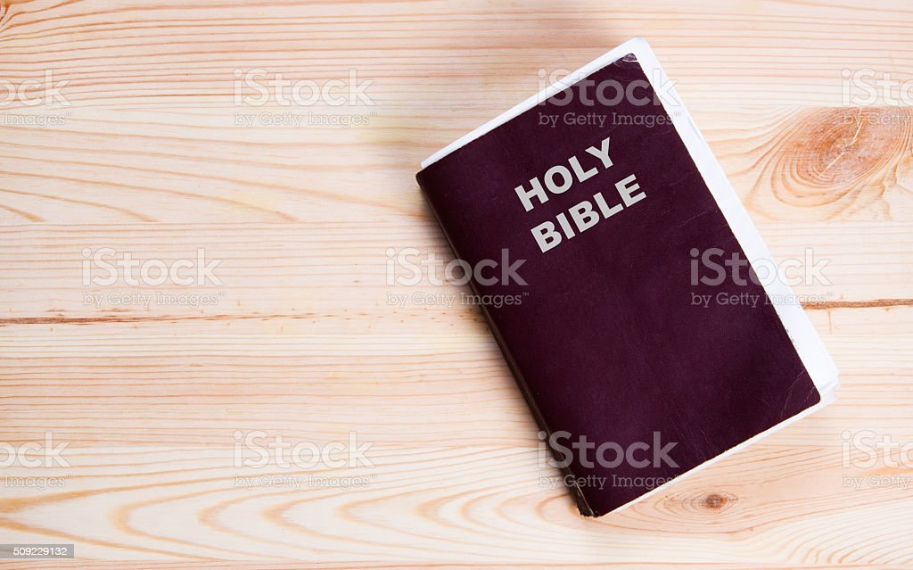 Holy Bible on old wooden church table stock photo
