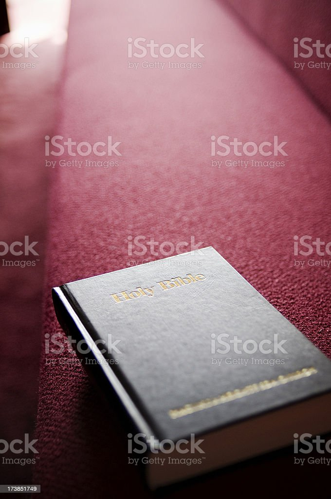 Holy Bible on Pew stock photo