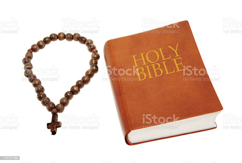 Holy Bible with a rosary stock photo