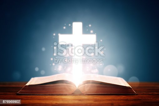 istock Holy Bible with cross 876969902